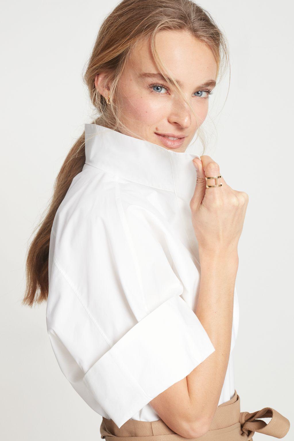 White shirt with raised collar