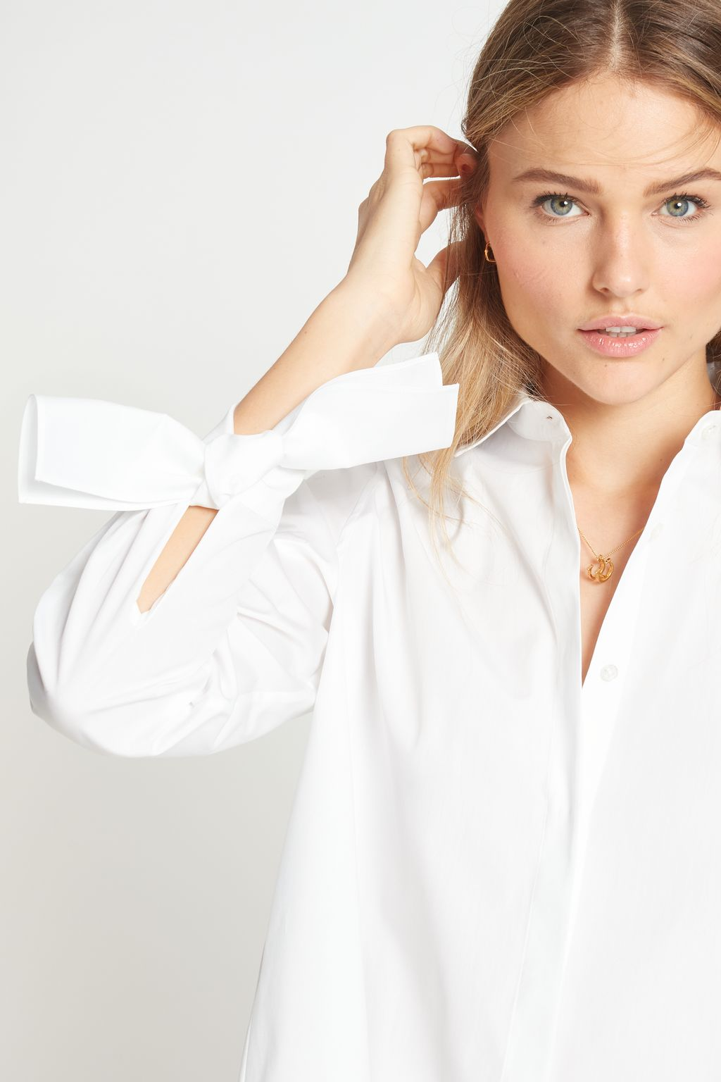 White shirt with bows