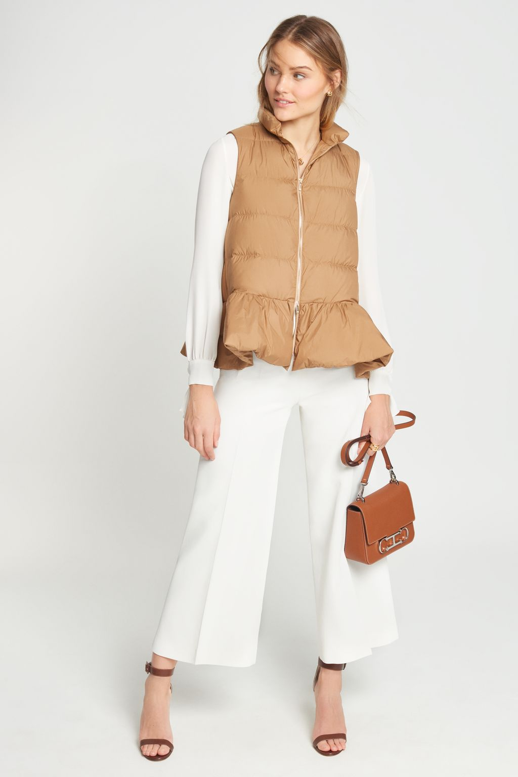 Quilted gilet with ruffled hem