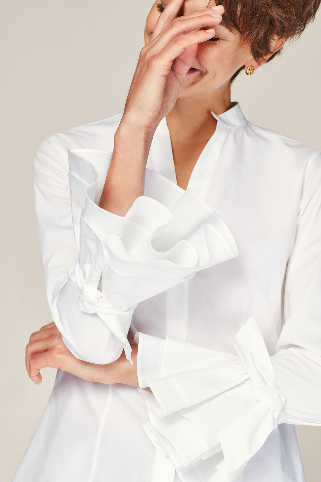 White shirt with ruffled sleeves