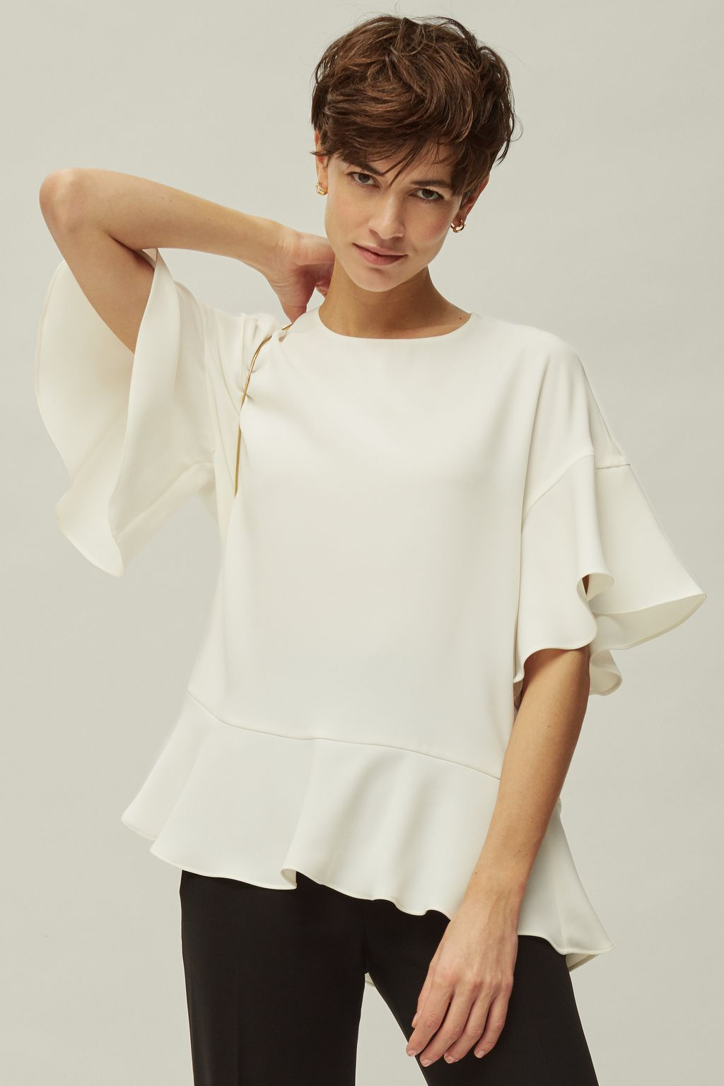 Oversized top with ruffles
