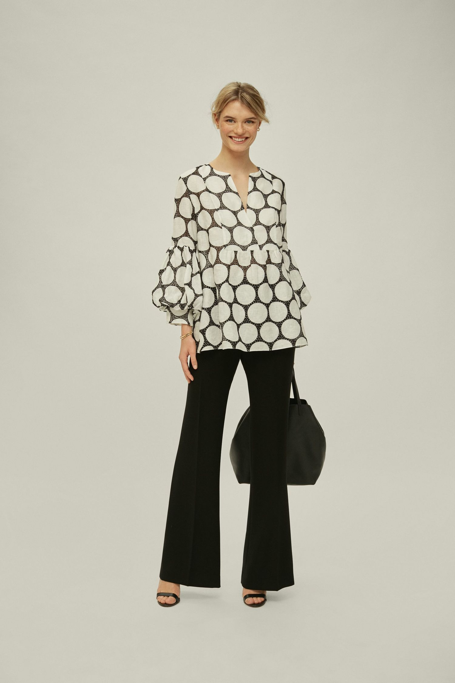 Polka dot perforated linen blouse