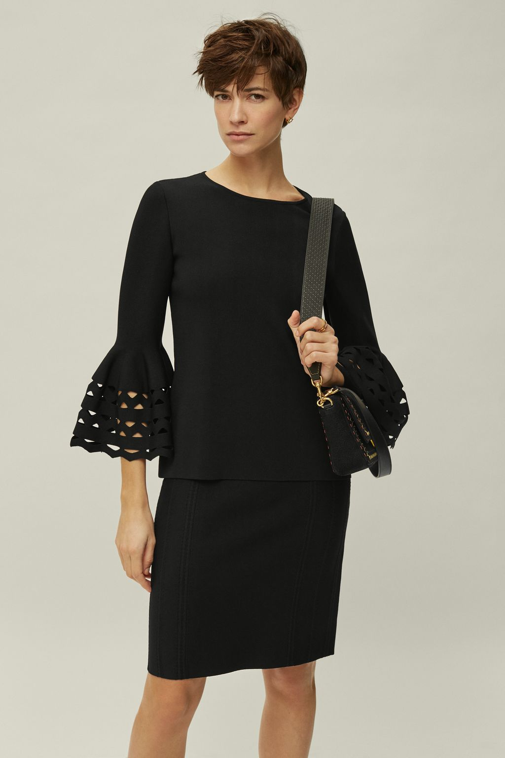 Stretch-knit top with perforated sleeves