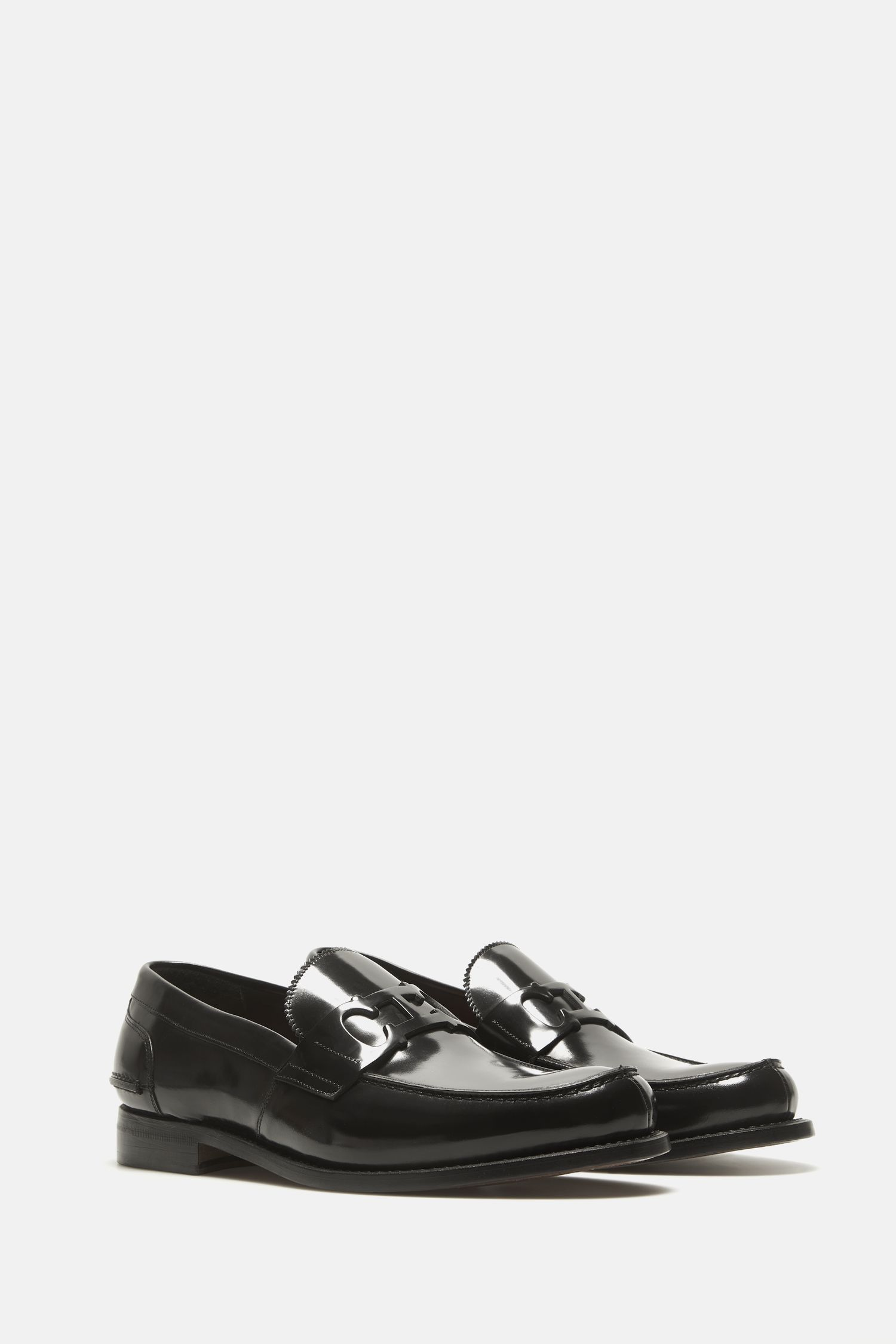 Initials Insignia cutout leather loafers