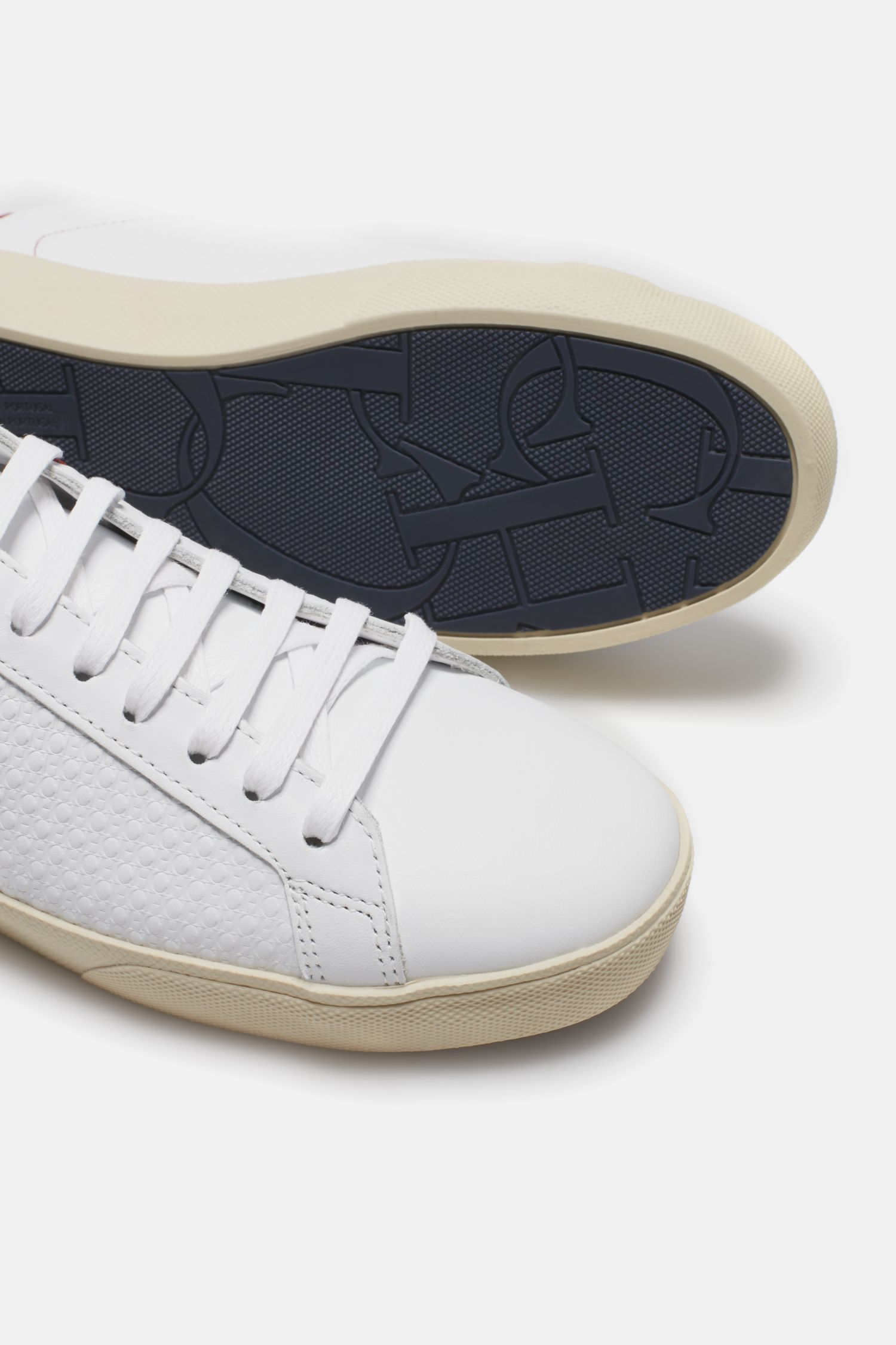 CH-embossed leather sneakers